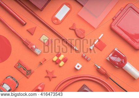 Top View Of Red Objects On A Red Background. Ordinary Objects That Everyone Has In The House