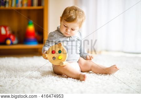 Adorable Baby Girl Playing With Educational Toys . Happy Healthy Child Having Fun With Colorful Diff