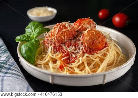 Delicious Spaghetti Pasta With Meatballs, Parmesan And Tomato Sauce, Selective Focus