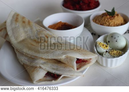 Dosa Rolls With Beetroot Masala Inside. Locally Known As Beetroot Masala Dosa. Served With Boiled Eg