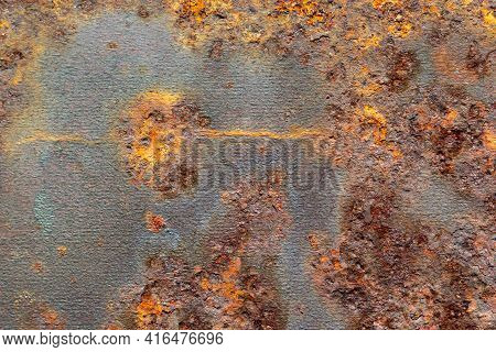 Metal Covered With Rust. Rusty Sheet Metal. Background Of Rusty Metal.
