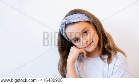 Child Portrait. Advertising Background. Kid Imagination. Pensive Relaxed Sweet Little Girl Daydreami