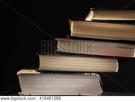 Concept Of Progress In Education, Reading. Stairs From Stack Of Books On Black Background