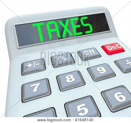 A plastic calculator displays the word Taxes symbolizing the need to file annual tax returns