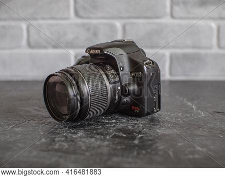 Russia, Krasnodar - April 2, 2021: Old Canon Rebel T1i Or 500d Amateur Slr Camera With 18-55mm Whale