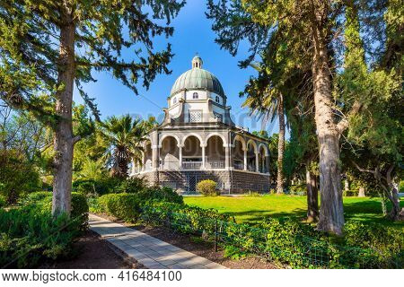 The Sea of Galilee. The Catholic Church of the Beatitudes of the Italian Franciscan monastery on Mount Bliss. Israel. Blooming huge park around the monastery. The concept of religious pilgrimage