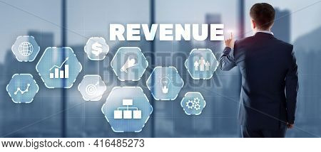 Increase Revenue Concept. Businessman Pressing Inscription Revenue