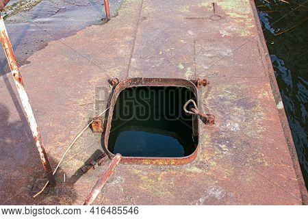 Old Rusty Sunken Pier In The Water On The Territory Of The River Port. Old Sunken Rusty Structure On