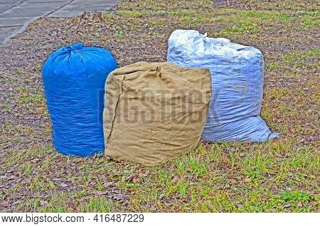 Few Bags Trash On The Grass, Polluted Environment Diversity