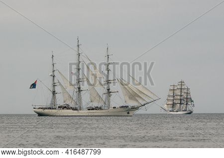 Swinoujscie, West Pomeranian / Poland - 2017: Sailing Ship Rnov Shabab Oman And Cisne Branco Flows T