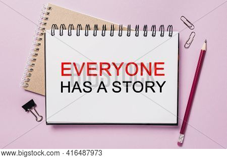 Text Everyone Has A Story On A White Sticker With Office Stationery Background. Flat Lay On Business