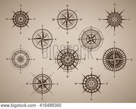 Set Of Compass Rose Or Wind Rose On Brown Vintage Background