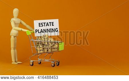 Estate Planning Symbol. Miniature Shopping Cart With Wooden Houses, Words Estate Planning. Wooden Mo