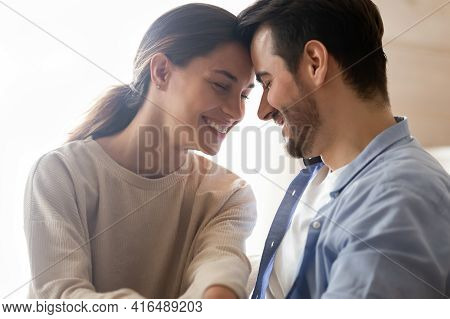 Close Up Of Happy Couple Lovers Hugging