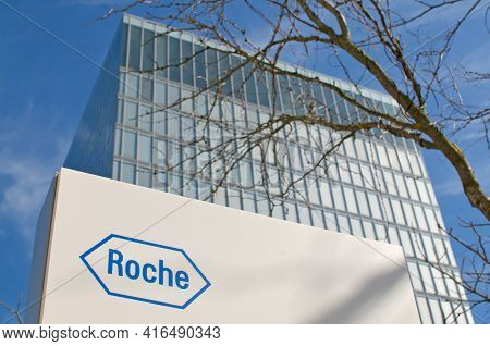 Rotkreuz, Zug, Switzerland - 28th March 2021 : Roche Sign In Front Of The Roche Diagnostics Tower In