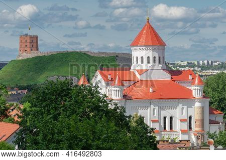 View Of Vilnius Old Town In Summer. In Front - One Of The Oldest Christian Shrines In The City - Cat