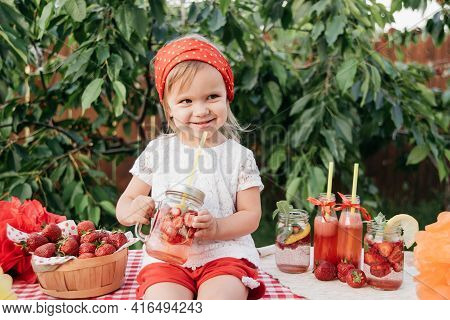 Lemonade Stand. Adorable Little Girl Trying To Sell Lemonade. Strawberry Lemonade With Ice And Mint