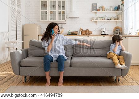 Disturbed Nanny Call Parents For Advice To Calm Crying Offended Little Kid. Young Mom With Upset Son