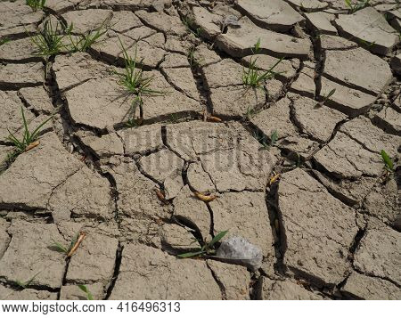 Deep Cracks In The Land As A Symbol Of Hot Climate And Drought. Desert And Cracked Ground. Uneven, S