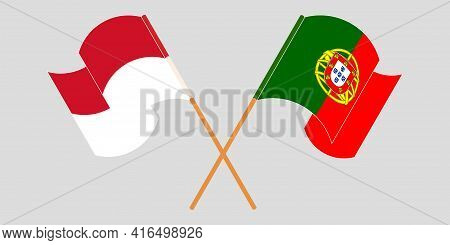 Crossed And Waving Flags Of Indonesia And Portugal