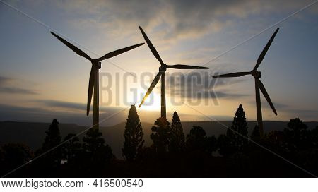 Concept Idea Eco Power Energy. Wind Turbine On Hill With Sunset. Wind Turbine Producing Alternative