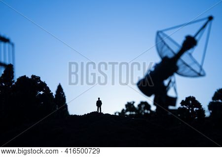 Creative Artwork Decoration. Silhouette Of Mobile Air Defence Truck With Radar Antenna During Sunset