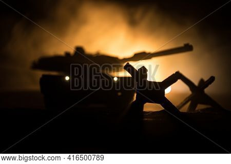 War Concept. Armored Vehicle Silhouette Fighting Scene On War Foggy Sky Background At Night. America