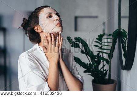 Woman Does Facial Rejuvenation Treatments At Home