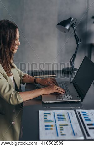 Woman Working At Her Desk With A Laptop