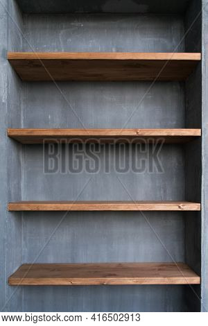Shelves In The Home Interior. Natural Materials Concrete And Wood.