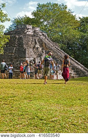 Chaccoben, Mexico - January 2, 2018: Visitors Explore The Chacchoben Maya Ruins, One Of The More Pop