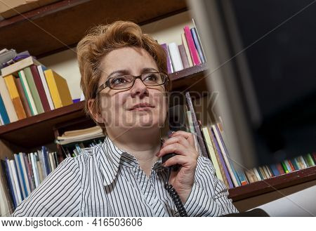 Image Of A Busy Woman Telecommuting At Her Desk At The Home. Working At Home Became An Important Rec