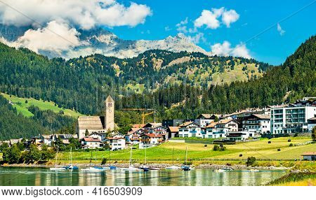 Church In Reschen Am See Or Resia, A Village On Lake Reschen In South Tyrol, Italy