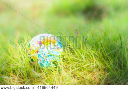 Globe Or Earth On Grass With Green Blured. Saving  Protect, Environment, Arbor Day, Card For World E