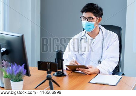 New Normal, Medical Team Wearing Medical Masks Technology Network Team Meeting Concept. Doctor At A
