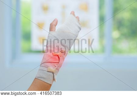 Tying Bandage On The Wrist Of Patient In Clinic, Osteophytes And Heel, Fascia, Orthopedic Doctor