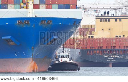 Oakland, Ca - Apr 3, 2021: Tugboats Are Small Yet Powerful For Their Size. Tugboat Assist Cargo Ship