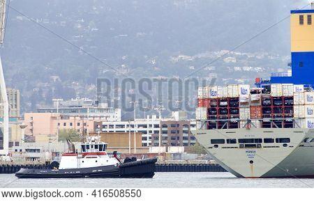 Oakland, Ca - Apr 5, 2021: Tugboat Jamie Renea At The Stern Of Matson Cargo Ship Manoa, Assisting Th