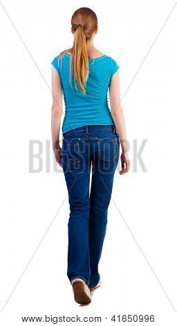 back view of walking  woman  in   jeans and shirt. beautiful blonde girl in motion.  backside view of person.  Rear view people collection. Isolated over white background.