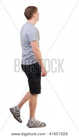 Back view of walking handsome man in shorts and sneakers.   going young guy. Rear view people collection.  backside view of person.  Isolated over white background.