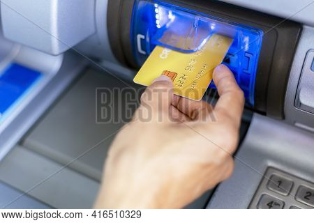 Close Up Hand Of Women With A Credit Card, Using An Atm. Women Using An Atm Machine With His Credit