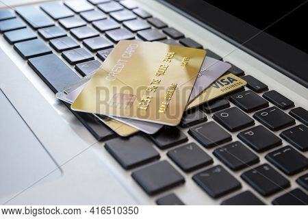 Close Up Credit Card On Laptop Of Business Workplan. Many Credit Card On Laptop Keyboard Of Online S