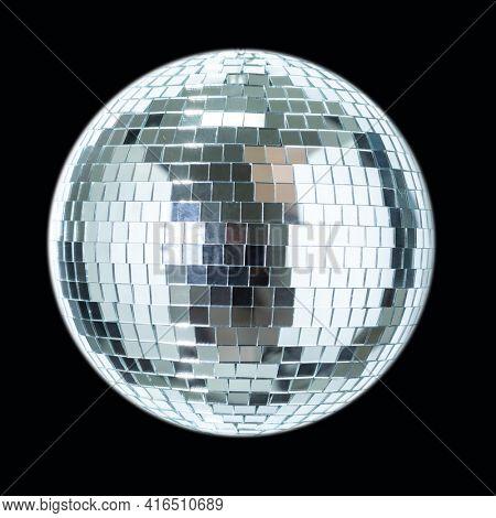 Shining Disco Ball dance music event equipment isolated on dark black background
