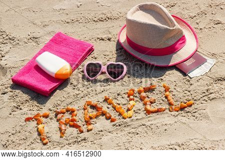 Inscription Travel Made Of Amber Stones, Accessories For Sunbathing And Passport With Currencies Dol