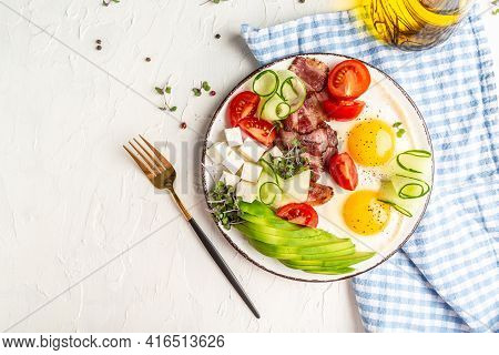 Healthy Nutritious Paleo Keto Breakfast Diet Fried Eggs, Bacon, Avocado, Cheese And Fresh Salad. Ket