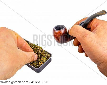 Pipe For Smoking Tobacco In The Hand Of A Smoker On A White Background. Wooden Pipe For Smoking. Tob