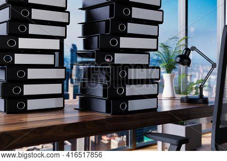 Large Stacks Of Office Binder File Folder On Wooden Desk In Office; Skyline View; Burnout Overworked