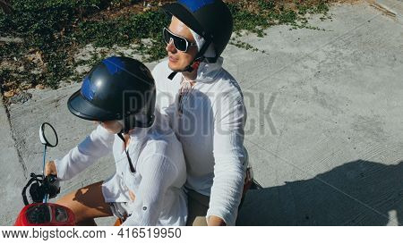 Two Caucasian Tourist Woman Man Drive On Red Scooter. Make It Selfie. Love Couple On Motorbike In Wh