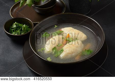Griessnockerlsuppe. Clear Soup With Semolina Dumplings In A Bowl. German Food. Bavarian Cuisine.