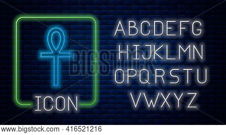 Glowing Neon Cross Ankh Icon Isolated On Brick Wall Background. Neon Light Alphabet. Vector